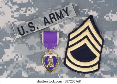 KIEV, UKRAINE - March 6, 2016. Purple Heart  award on US ARMY camouflage uniform