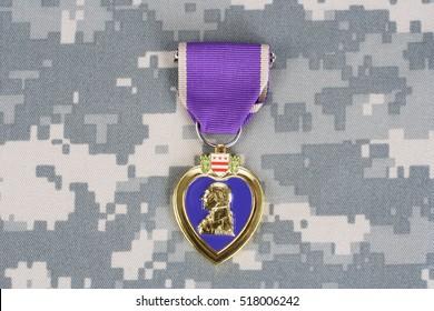 KIEV, UKRAINE - March 6, 2016. Purple Heart award on camouflage uniform