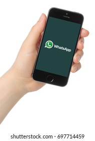 Kiev, Ukraine - March 7, 2015:Hand holds iPhone 5s Space Gray with WhatsApp logo on white background.