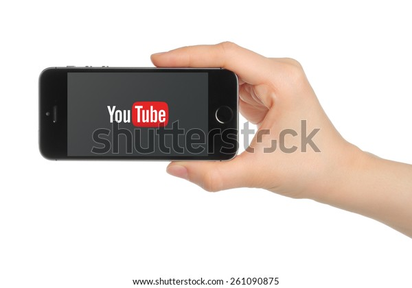 KIEV, UKRAINE - MARCH 7, 2015:Hand holds iPhone 5s Space Gray with YouTube logo on white background. YouTube is a video-sharing website