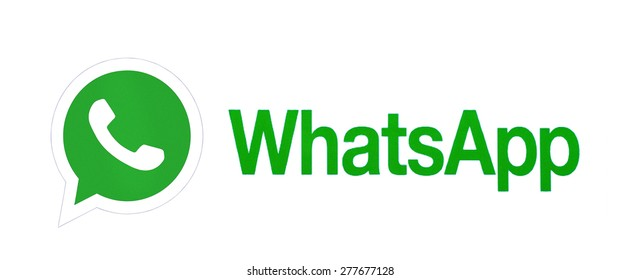 KIEV, UKRAINE - MARCH 8, 2015:WhatsApp Messenger logotype printed on paper. WhatsApp Messenger is an instant messaging app for smartphones that operates under a subscription business model.