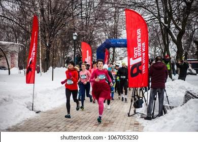 Kiev, Ukraine - March 8, 2018: Women's race in honor of the International Women's Day. Do sport. Running in the winter. Half marathon among women.