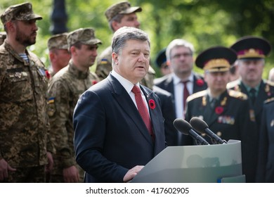 KIEV, UKRAINE - May 09, 2016: On occasion of 71st anniversary of Victory over Nazism in the World War II President Poroshenko prayed for peace and victory of Ukraine together with military chaplains