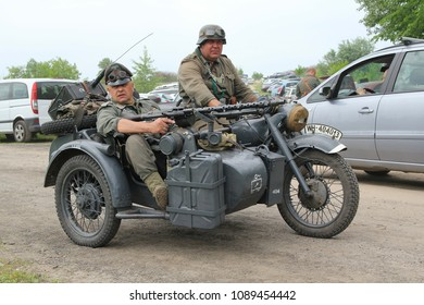 Kiev, Ukraine - May 09, 2018: Men in the clothes of German soldiers on a motorcycle at the historic reconstruction on the anniversary of the victory in the Second World War