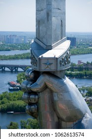 "Kiev, Ukraine - May 10, 2015: Close-up detail (The hand holds the sword) of the monument ""Motherland"", devoted to the Great Patriotic War."