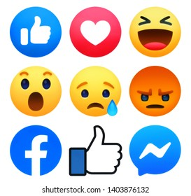 Kiev, Ukraine - May 10, 2019: New Facebook like button 6 Empathetic Emoji Reactions with Messenger and Like symbol printed on white paper. Facebook is a well-known social networking service.