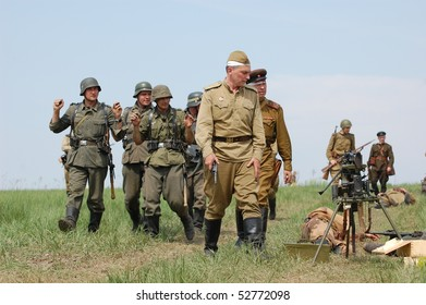 KIEV, UKRAINE - MAY 10 :  Members of Red Star history club wear historical German&Soviet uniform during historical reenactment of 1945 WWII, May 10, 2010 in Kiev, Ukraine.
