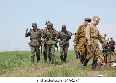 KIEV, UKRAINE - MAY 10 : Members of Red Star history club wear historical German&Soviet uniform during historical reenactment of 1945 WWII, May 10, 2010 in Kiev, Ukraine