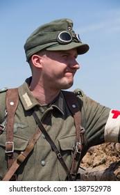 KIEV, UKRAINE -MAY 11: Member of Red Star history club wears historical German uniform during historical reenactment of WWII, May 11, 2013 in Kiev, Ukraine