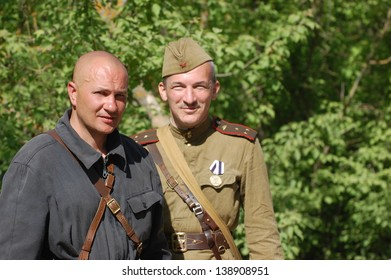KIEV, UKRAINE - MAY 11 : An unidentified members of Red Star history club wear historical Soviet uniform during historical reenactment of WWII on May 11, 2013 in Kiev, Ukraine