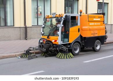 Kiev, Ukraine - May 12, 2018:New street sweeper machine cleans the city street