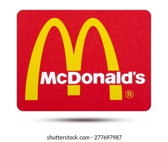 KIEV, UKRAINE - MAY 13, 2015: fast food chain McDonald's   printed on paper and placed on white background.  It is the world's largest chain of hamburger fast food restaurants.