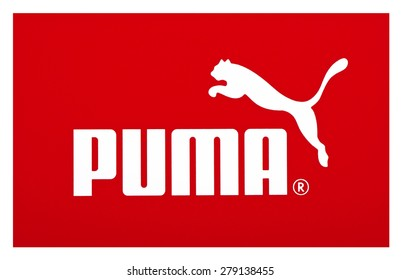 KIEV, UKRAINE - MAY 13, 2015: Logo of brand Puma printed on paper and placed on white background. Puma is a German company that produces athletic and casual footwear and sportswear.