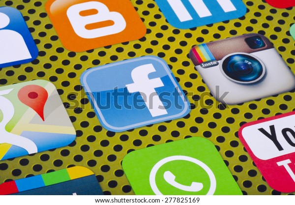KIEV, UKRAINE - MAY 13, 2015: Popular social media  Facebook, linkedin, instagram, WhatsApp, Google maps,  blogger and others logos printed on paper.