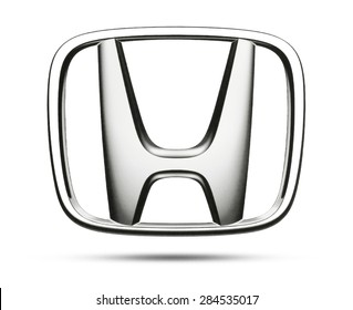 KIEV, UKRAINE - MAY 13, 2015:Honda logotype printed on paper and placed on white background. Honda international industrial company for the production of cars and motorcycles.