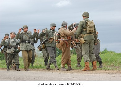 KIEV, UKRAINE -MAY 13: Members of Red Star history club wear historical German and American  uniforms during historical reenactment of WWII, May 13, 2012 in Kiev, Ukraine