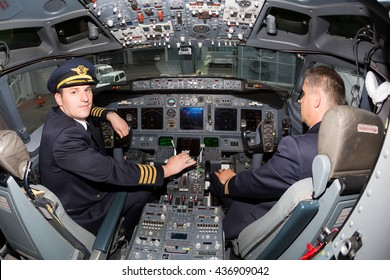 Kiev, Ukraine - MAY 14, 2015: Portrait of pilots in cockpit. Captain pilot. Boeing 737 cockpit. Airline pilots. Pilot uniform. Pilots at work.