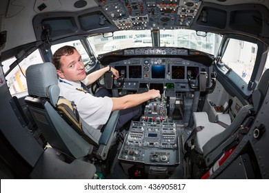 Kiev, Ukraine - MAY 14, 2016: Portrait of pilot in cockpit. Captain pilot. Boeing 737 cockpit. Pilot at work. Professional theme.