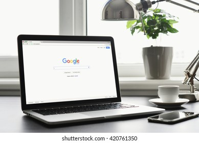 Kiev, Ukraine - May 15, 2016: Macbook Pro with Google homepage on screen. Google biggest Internet search engine. Google.com domain was registered September 15, 1997.