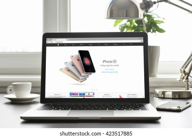 Kiev, Ukraine - May 15, 2016:Front view Macbook Pro with with Retina display presenting new generation of iPhone SE series on screen. iPhone SE was released on March 31, 2016  by Apple Inc.