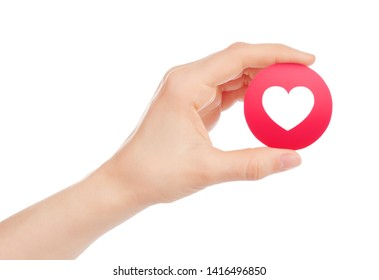 Kiev, Ukraine - May 15, 2019: Hand holds new Facebook Love Empathetic Emoji Reaction, printed on paper. Facebook is a well-known social networking service