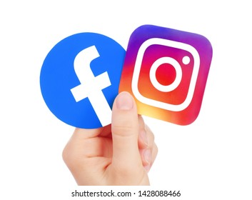Kiev, Ukraine - May 15, 2019: Hand holds new Facebook logo and Instagram printed on paper. Instagram is a photo and video-sharing social networking service owned by Facebook.