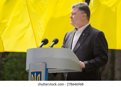"KIEV, UKRAINE - May. 17, 2015: President of Ukraine Petro Poroshenko speaks on Remembrance Day of Victims of Political Repression in the National Historical Memorial Reserve ""Bykivnia Graves"""