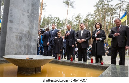 """KIEV, UKRAINE - May. 17, 2015: Participants in the ceremony of laying flowers to the Memorial Day of Victims of Political Repression in the National Historical Memorial Reserve """"Bykivnia Graves"""""""