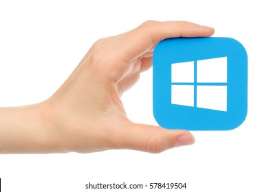 Kiev, Ukraine - May 17, 2016: Hand holds Microsoft Windows icon printed on paper