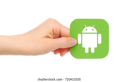 Kiev, Ukraine - May 18, 2016: Hands holds Google Android icon printed on paper. Android is a mobile operating system developed by Google.