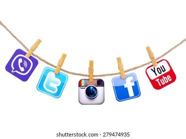 KIEV, UKRAINE - MAY 19, 2015: Popular social media Facebook, instagram, Viber, Twitter, YouTube hanging on the clothesline isolated on white background.