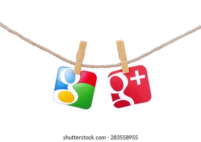 KIEV, UKRAINE - MAY 19, 2015: Popular social media Google  and  Google plus  hanging on the clothesline isolated on white background.