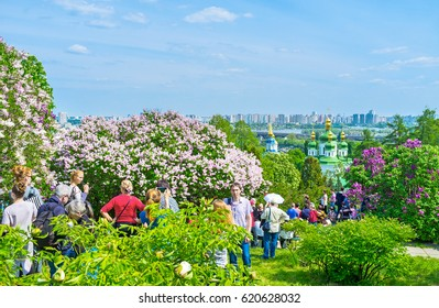 KIEV, UKRAINE - MAY 2, 2016: Visitors of Botanical Garden go inside lilac garden to enjoy aroma of flowers and great view on greenery of the garden, on May 2, in Kiev