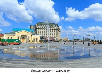 Kiev, Ukraine - May 20, 2017: People walking near the fountain on Poshtova Square in Kiev , Ukraine.