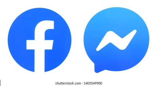 Kiev, Ukraine - May 20, 2019: New Facebook logo and Messenger printed on white paper.