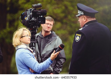 Kiev, Ukraine - MAY 2017: police give interviews to journalists in the framework of the program of safety of traffic on the streets and the threat of terrorism.