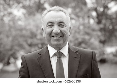 Kiev, Ukraine, May 2017 : Portrait happy Mature businessman  on the nature. Good life for adults. . Illustrative editorial