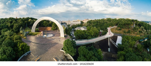 KIEV, UKRAINE - MAY 2019: Aerial panoramic view of People's Friendship Arch (opened on November 7, 1982) and the new pedestrian bridge (opened on May 25, 2019) connecting to Saint Volodymyr Hill.