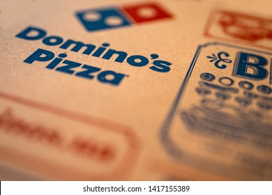 KIEV, UKRAINE - MAY 2019: Domino's Pizza Box detail. Domino's, is an American pizza restaurant chain founded in 1960, in 2018 the chain became the largest pizza seller worldwide in terms of sales.