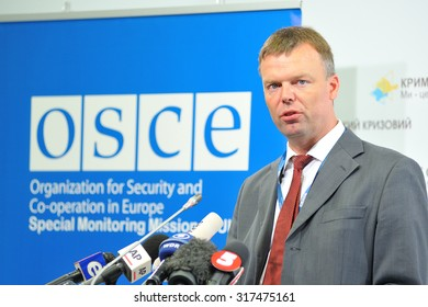 KIEV, UKRAINE - MAY 21, 2015: Alexander Hug, Deputy Chief Monitor of the OSCE SMM in Ukraine reads a report of the current state in the occupied territory of Ukraine at a press briefing