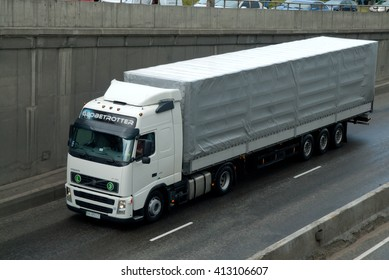 Kiev, Ukraine - May 25, 2009. Truck Volvo FN semi-trailers covered in rain