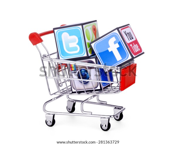 KIEV, UKRAINE - MAY 25, 2015: Cubes with logotypes of social media: Facebook, Twitter, instagram, placed into shopping cart .