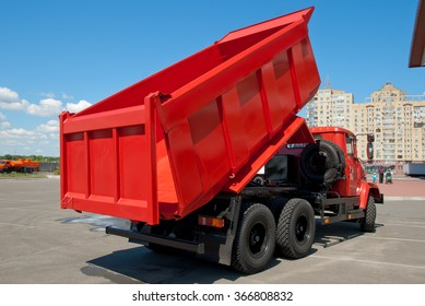 Kiev, Ukraine - May 26,  2009. Red dump truck with the body lifted for unloading.