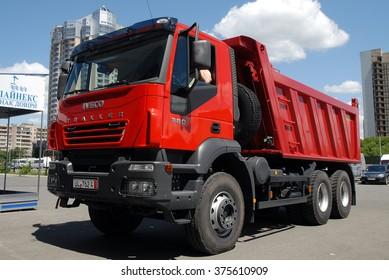 Kiev, Ukraine - May 26,  2009. Red dump truck Iveco Trakker.