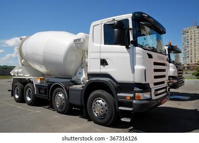 Kiev, Ukraine - May 26, 2009.A pair of white concrete mixers truck Scania