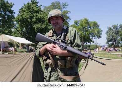 Kiev, Ukraine - May 27, 2018: Man in the uniform of a soldier of the American army during the Vietnam War at the festival of historical reconstruction