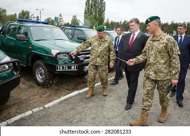 KIEV, UKRAINE - May. 28, 2015: President of Ukraine Petro Poroshenko inspects military equipment during his visit to the Mobile Border Detachment of the State Border Service of Ukraine