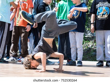 KIEV, UKRAINE - MAY 28, 2017: Bboy doing some stunts - Street artist breakdancing outdoors