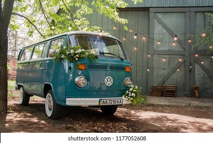 KIEV, UKRAINE - MAY 28, 2018: Blue classic Volkswagen Transporter T2 (Type 2)  retro vehicle parked near hangar. Automotive photography. Space for text. Background with car.  Wedding auto.