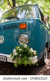 KIEV, UKRAINE - MAY 28, 2018: Blue classic Volkswagen Transporter T2 (Type 2). Retro vehicle. Automotive photography. Space for text. Background with car.  Wedding auto with flower decor.